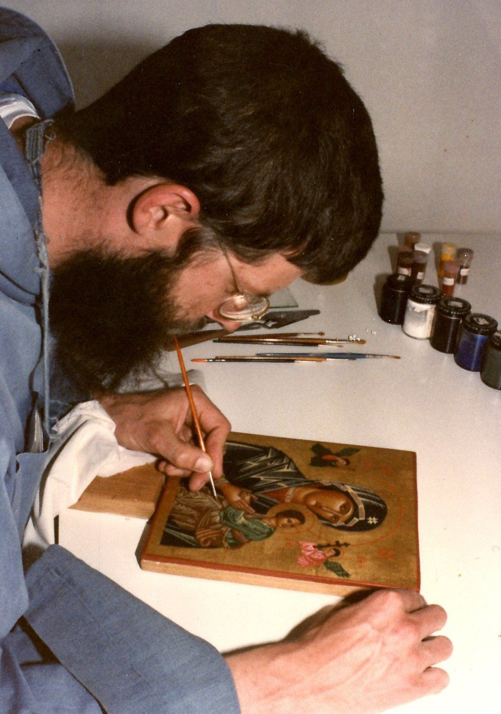 A younger Prior Christian writing an Icon