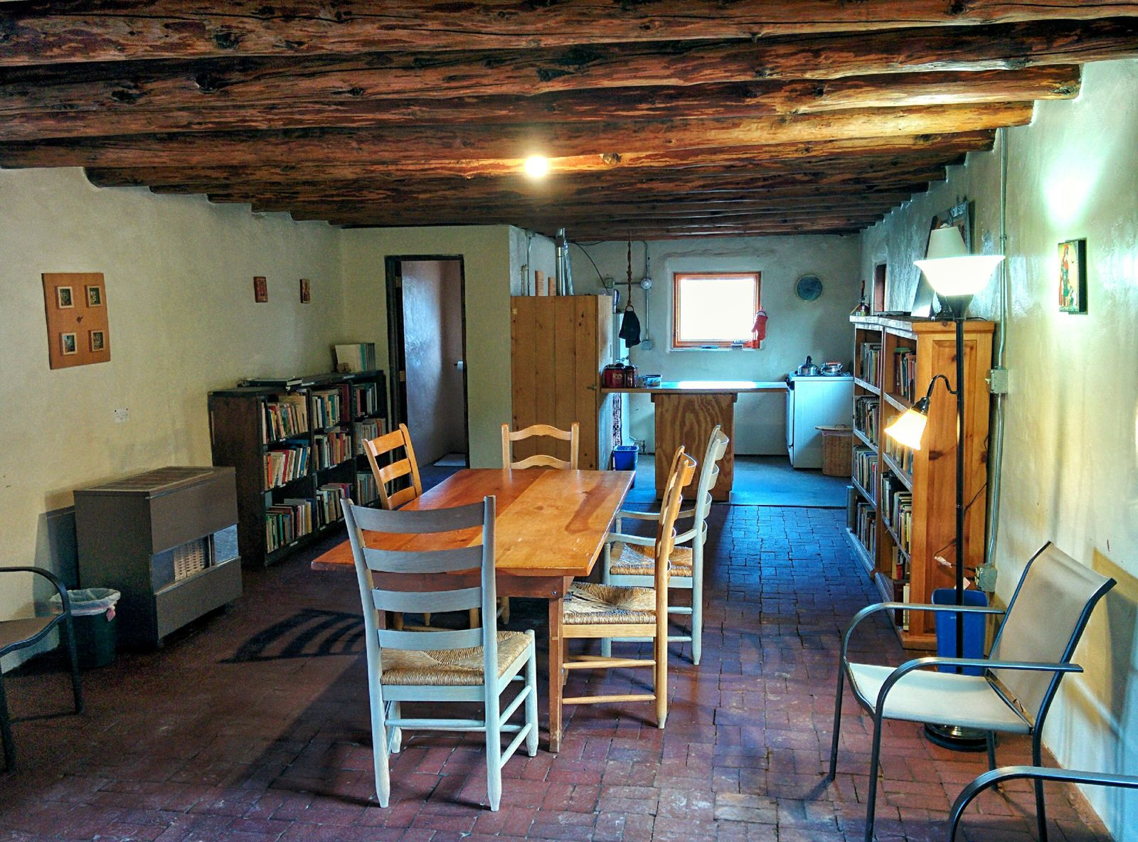 Guesthouse common area, kitchenette, and library