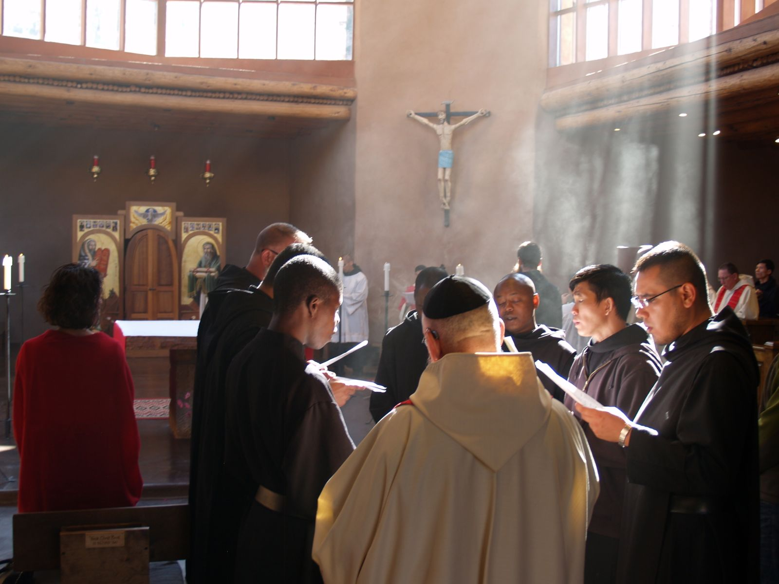 Abbot leads the Schola during Holy Mass