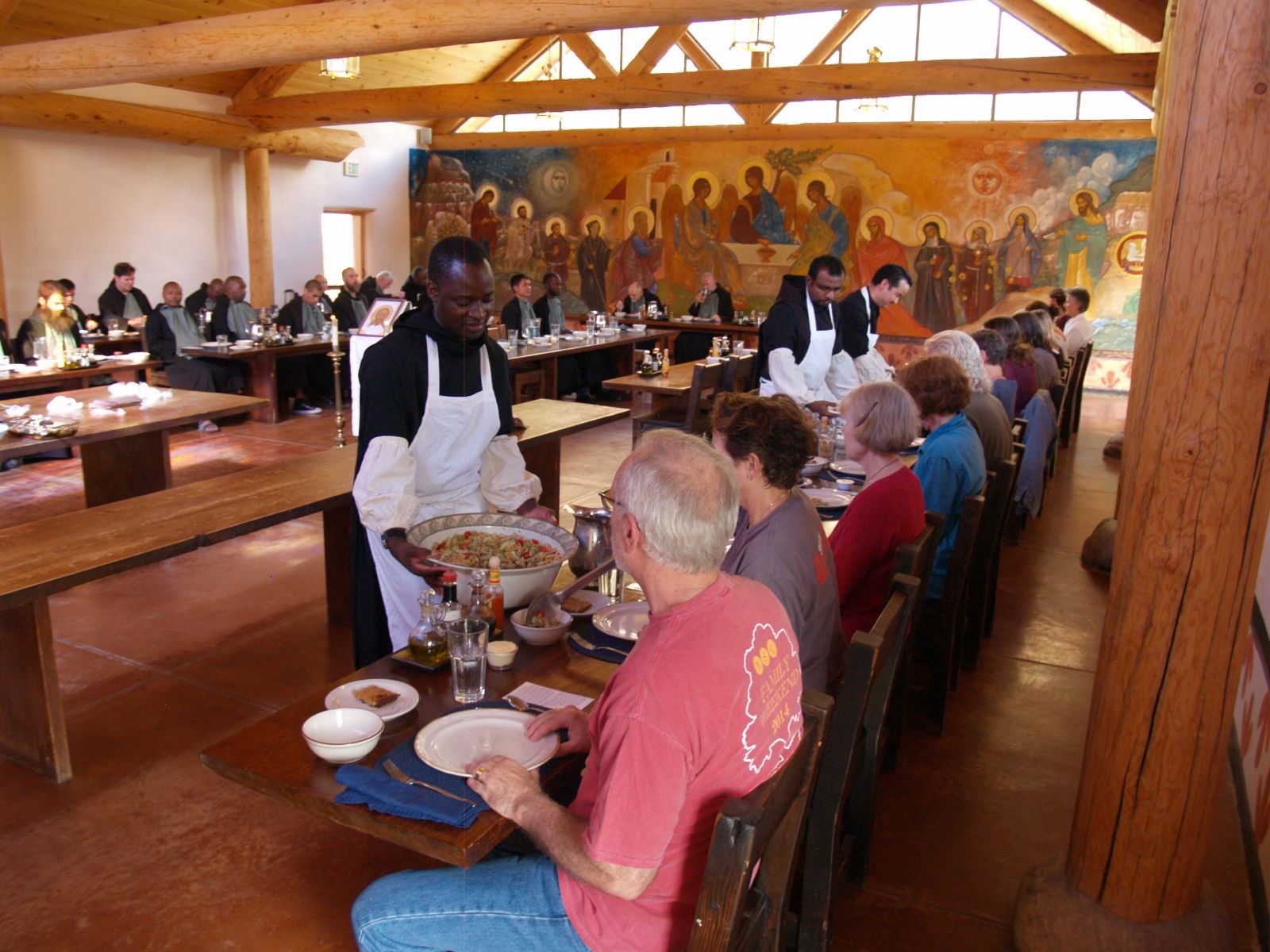 Brothers serving the guests in the refectory