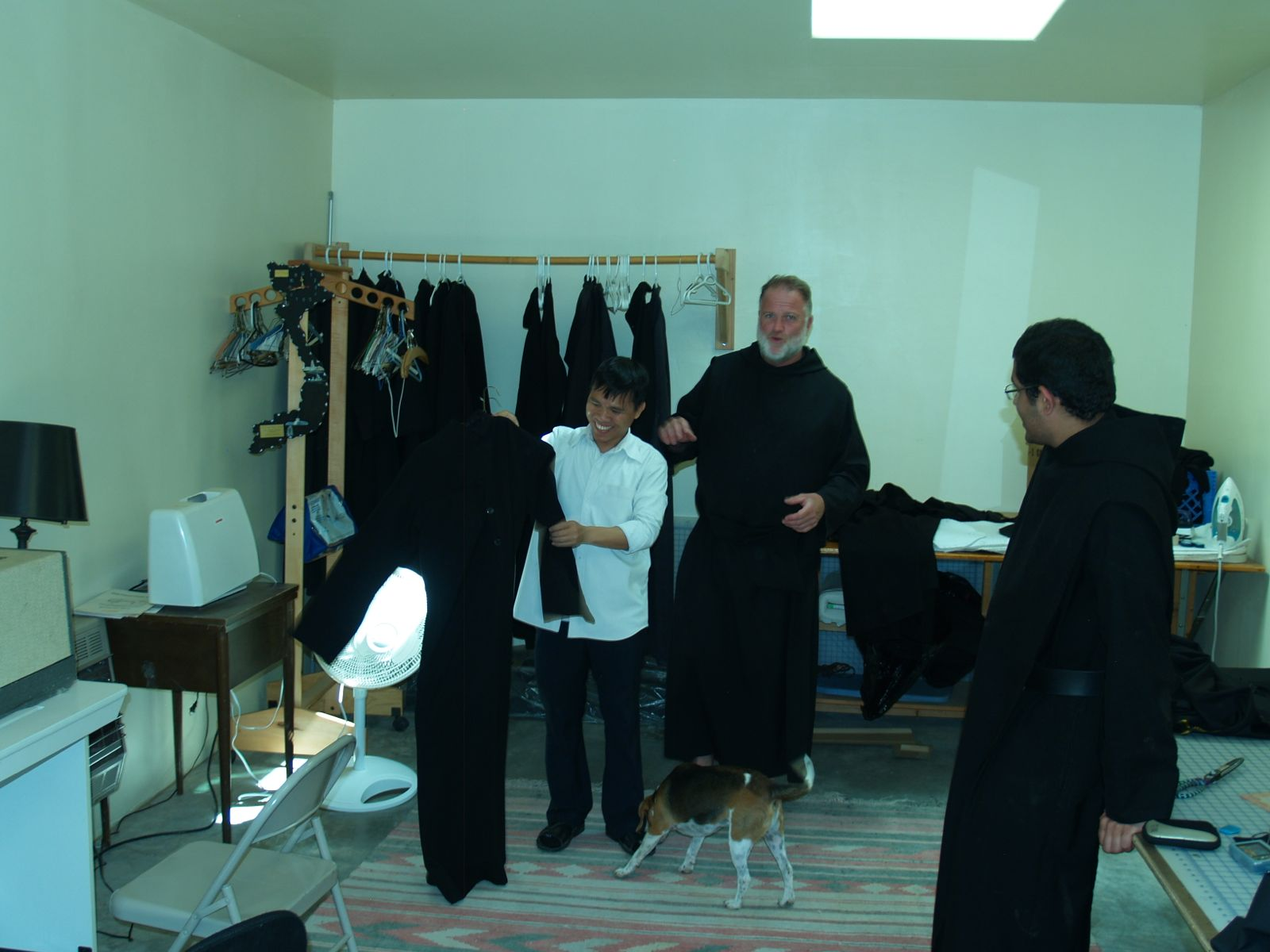 Monk being fitted for new habit