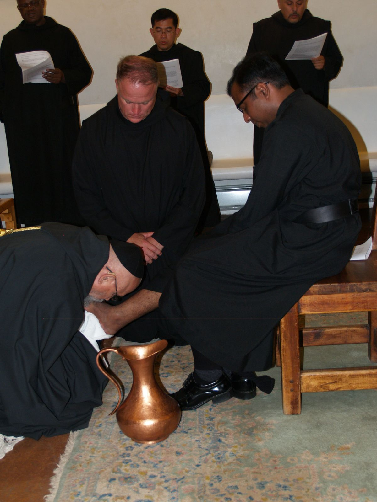 Washing and kissing of  the feet of a new novice.